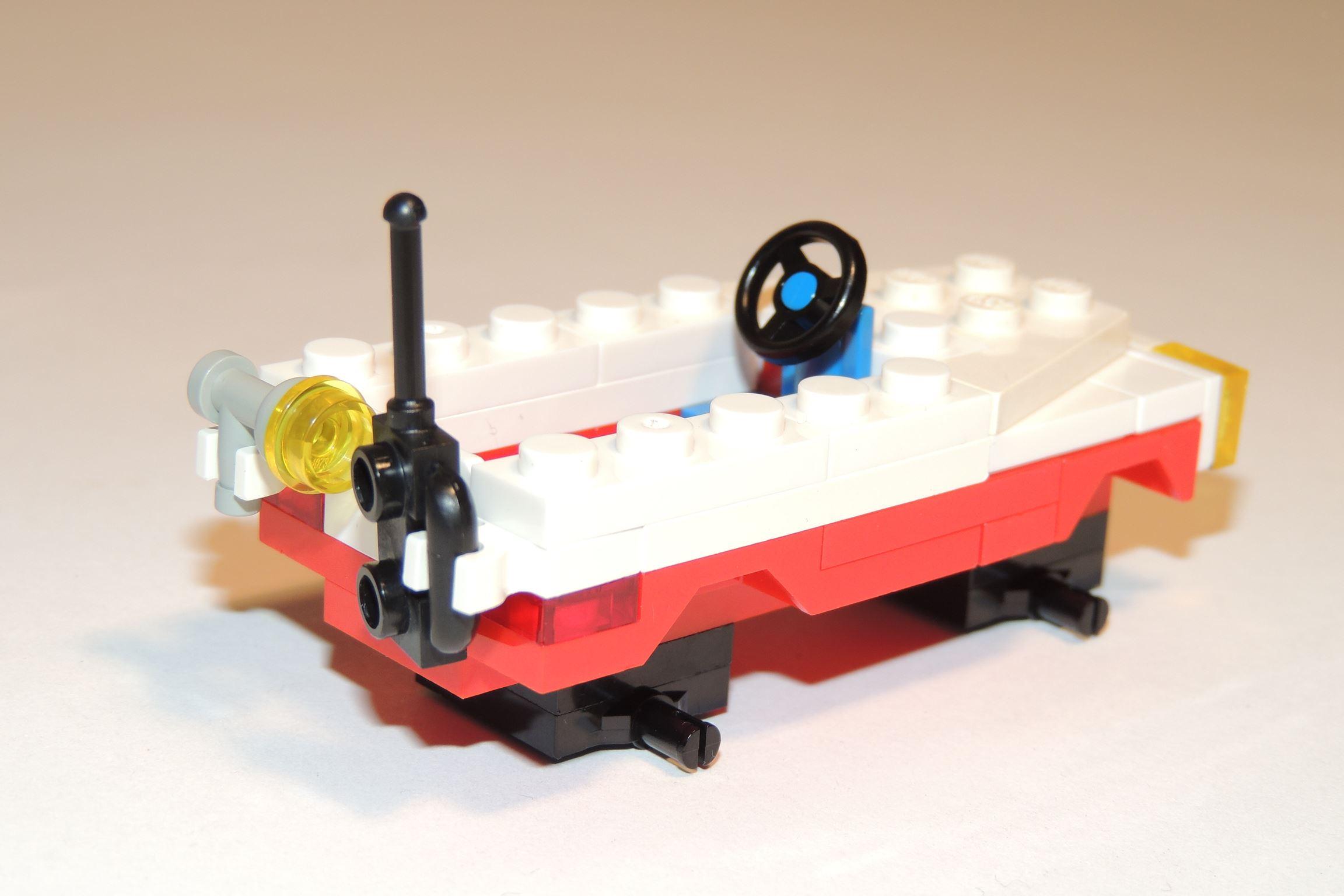 1×1 Roundplate in Transgelb von Gobricks. Ist ein Handscheinwerfer.